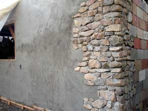 Slipform stone masonry projects and class information for How to install stone veneer over stucco