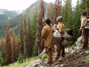 Modern hunter-gatherers wear buckskin clothing on a wilderness survival camping trip.